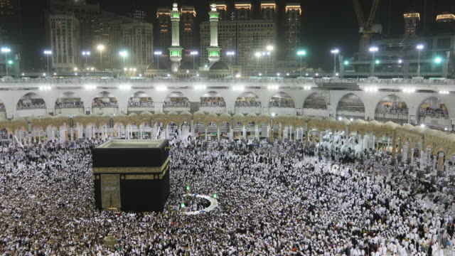 muslim pilgrims touring the holy kaaba in mecca in saudi arabia - islam stock videos & royalty-free footage