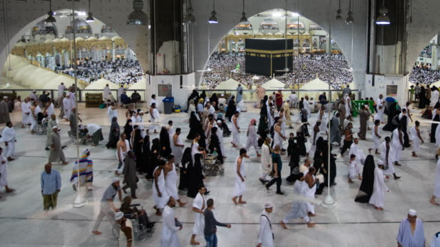muslim pilgrims touring the holy kaaba in mecca in saudi arabia - saudi arabia stock videos and b-roll footage