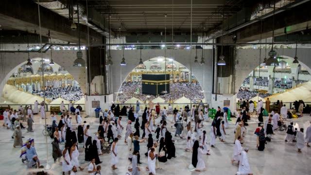muslim pilgrims touring the holy kaaba in mecca in saudi arabia - hajj stock videos & royalty-free footage