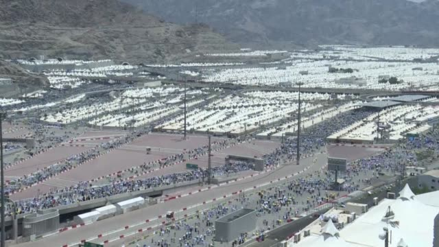 muslim pilgrims walk to take part in the symbolic stoning of the devil at the jamarat bridge in mina near mecca which marks the final major rite of... - hajj stock videos & royalty-free footage