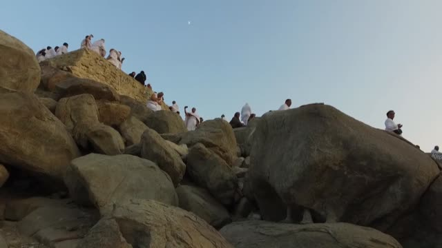 Muslim pilgrims walk towards a rocky hill known as Mount Arafat on September 10 2016 to prepare for the climax of the annual hajj pilgrimage near the...