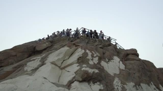 muslim prospective pilgrims climb the jabal alnour to visit hira cave during the annual hajj pilgrimage in mecca saudi arabia on august 24 2017 hira... - hajj stock videos & royalty-free footage