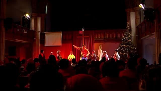 stockvideo's en b-roll-footage met muslim schoolchildren in birmingham visit church nativity play various of muslim primary schoolchildren watching nativity play performance in church - kerststal