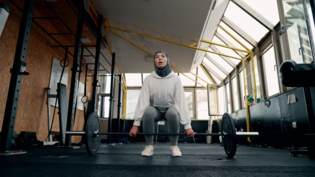 muslim sporty woman is having a weight training - retrieving stock videos & royalty-free footage