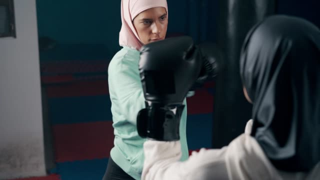 Muslim sporty women kickboxing