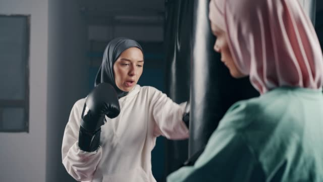 muslim sporty women kickboxing - challenge stock videos & royalty-free footage