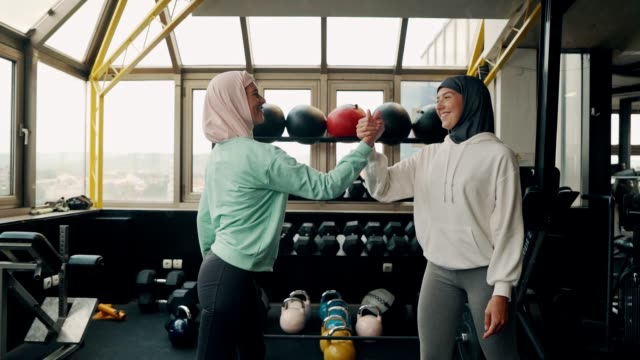 muslim sporty women working out with dumbbells - retrieving stock videos & royalty-free footage