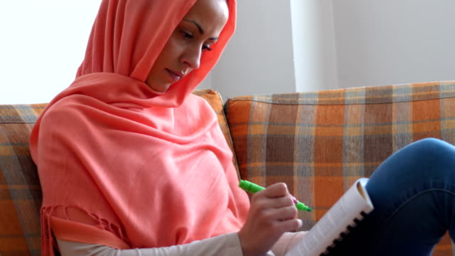 Muslim student learning at home