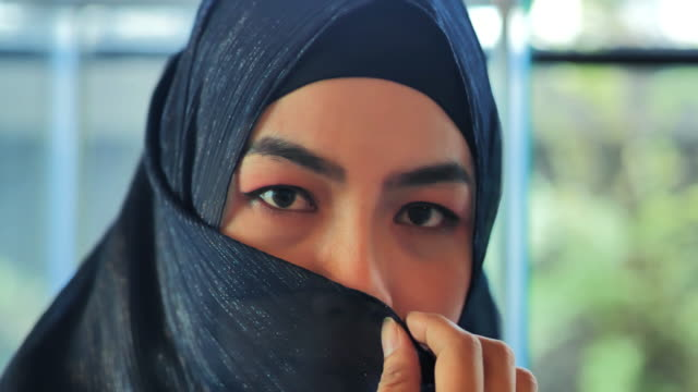muslim woman covers her face.arab youth - religious celebration stock videos & royalty-free footage