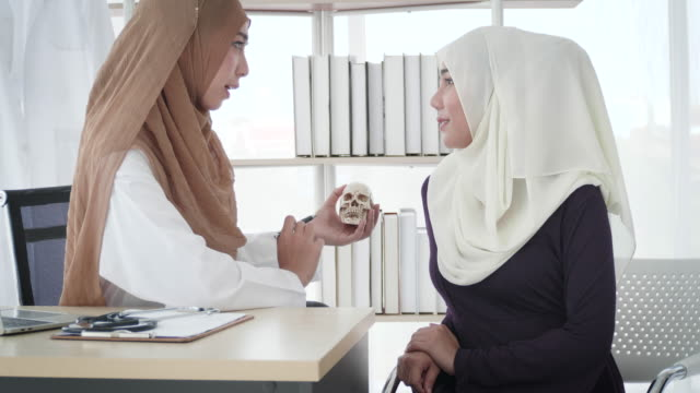 muslim woman doctor examining to muslim patient - medical occupation stock videos & royalty-free footage