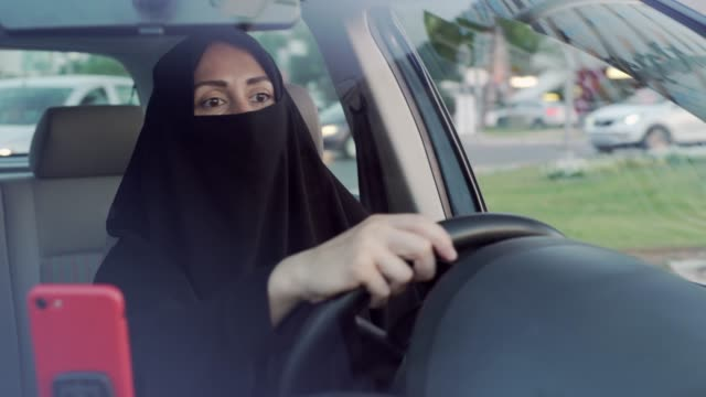 muslim woman driving a car - saudi arabia stock videos & royalty-free footage
