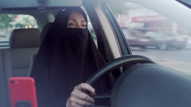 muslim woman driving a car - front view stock videos & royalty-free footage