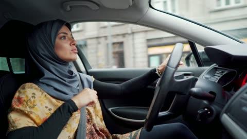 muslim woman enjoying favorite song in car - singing stock videos & royalty-free footage