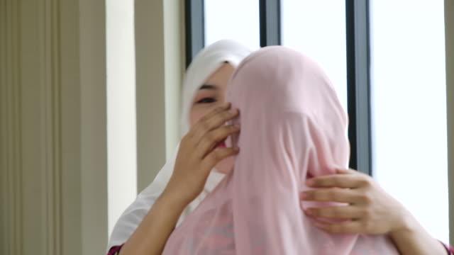 muslim woman greeting her friend - hijab stock videos & royalty-free footage