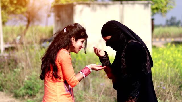 Muslim woman & her daughter