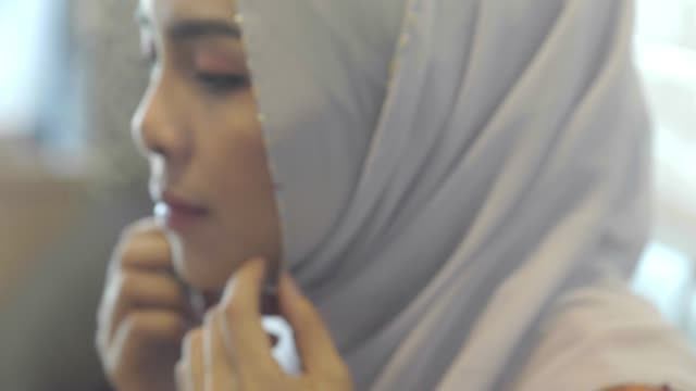 muslim woman in national clothes adjusting her hijab - tradition stock videos & royalty-free footage