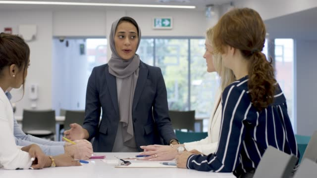 muslim woman leads meeting - multi ethnic group stock videos & royalty-free footage
