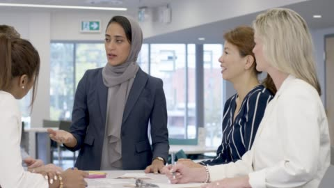 muslim woman leads meeting - place of work stock videos & royalty-free footage