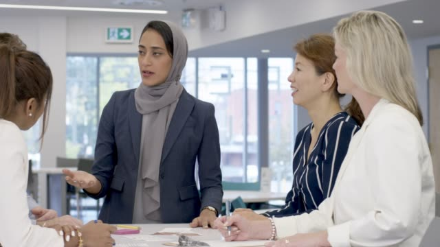 muslim woman leads meeting - diversity stock videos & royalty-free footage