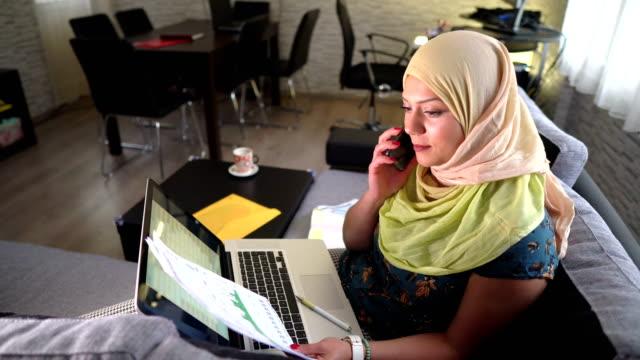 Muslim woman looking online for new investment opportunities!