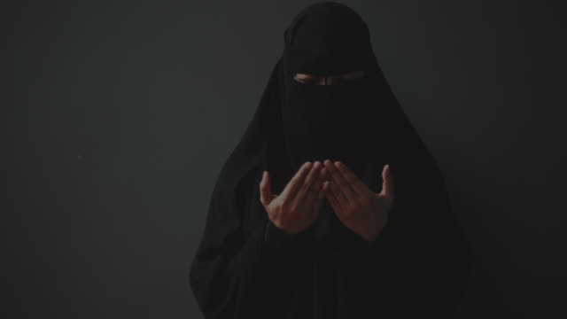 muslim woman praying to god - religion stock videos & royalty-free footage