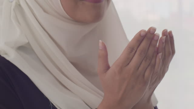 muslim woman praying - islam stock videos & royalty-free footage