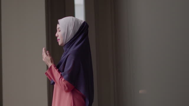 muslim woman praying with copy space. - praying stock videos & royalty-free footage