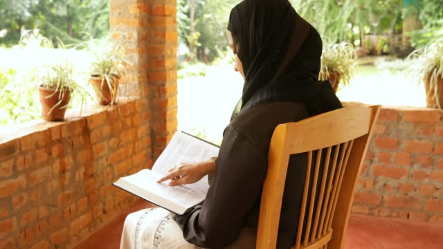 muslim woman reading book - wisdom stock videos & royalty-free footage