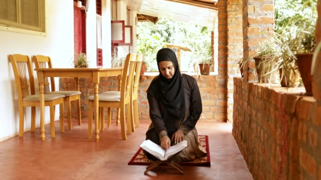 muslim woman reading quran - tradition stock videos & royalty-free footage