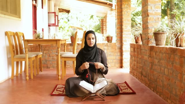 muslim woman reading quran - chanting stock videos and b-roll footage