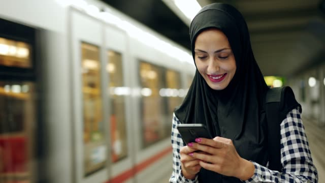 muslim woman reading text message - handheld stock videos & royalty-free footage