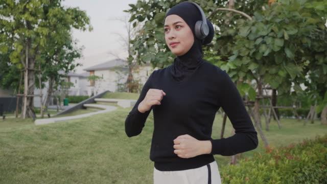 muslim woman sport - wireless technology stock videos & royalty-free footage
