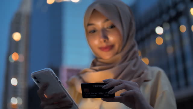 muslim woman using mobile devices for online shopping - banking stock videos & royalty-free footage
