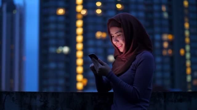 muslim woman using mobile phone - saudi arabia stock videos & royalty-free footage