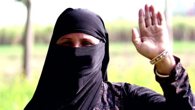 muslim woman waving hand - traditional clothing stock videos & royalty-free footage