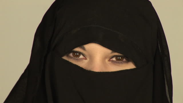 muslim woman wearing burqa/burkha veil - hd & pal - hijab stock videos and b-roll footage