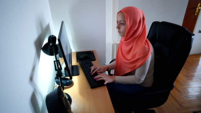 muslim woman working at home - middle eastern ethnicity stock videos & royalty-free footage