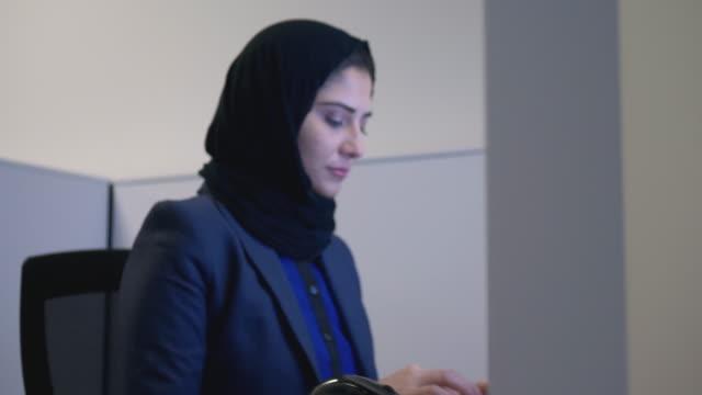 muslim woman working - females stock videos & royalty-free footage