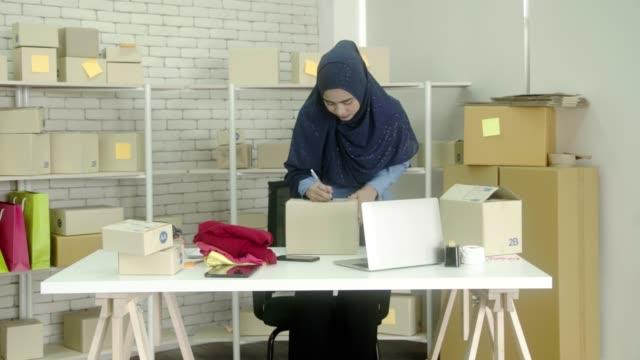 muslim women are packing. - selling stock videos & royalty-free footage