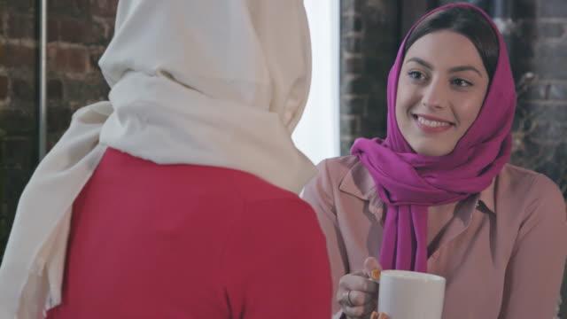 Muslim Women Enjoy Coffee or Tea Together