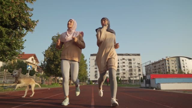 muslim women jogging on the running track - sportsperson stock videos & royalty-free footage