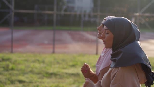 muslim women jogging on the running track - sportsperson stock videos & royalty-free footage