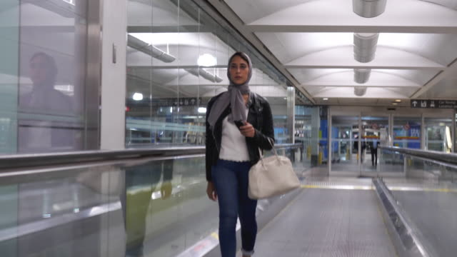 muslim women walking through airport - emigration and immigration stock videos & royalty-free footage
