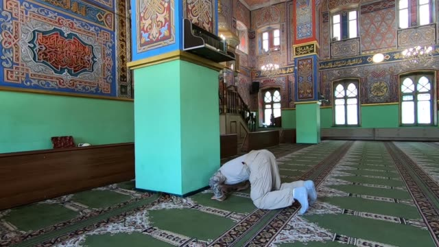 muslim worshiper praying inside mukhtarov mosque in vladikavkaz the capital city of the republic of north ossetia-alania in the north caucasian... - eddie gerald stock videos & royalty-free footage