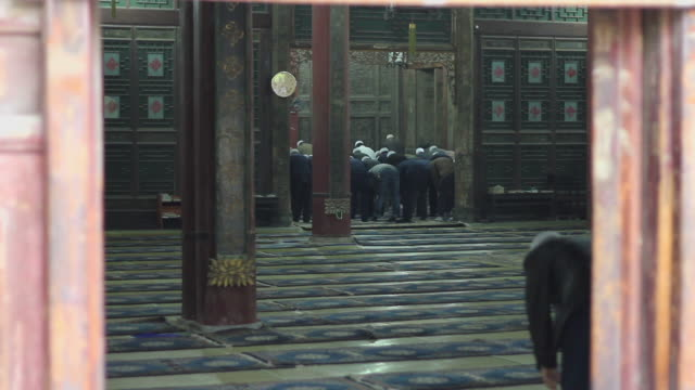 MS Muslim worshipers praying in mosque/xian,shaanxi,China