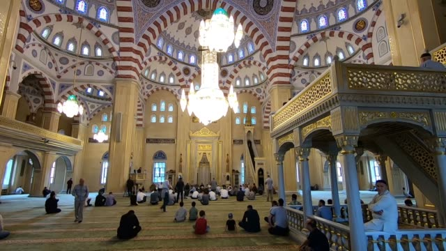 muslim worshipers praying inside akhmad kadyrov mosque in grozny the capital city of chechnya officially the chechen republic in the north caucasian... - eddie gerald stock videos & royalty-free footage