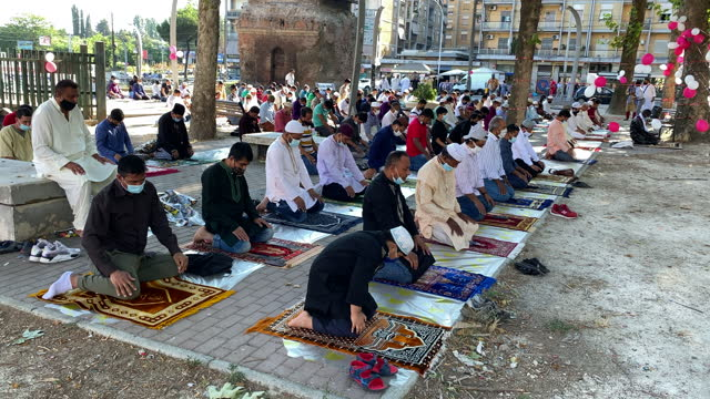 muslim worshippers of the bangladeshi community gather at the largo preneste for prayer led by the masjeed-e-ummah during eid al-adha on july 20,... - praying stock videos & royalty-free footage