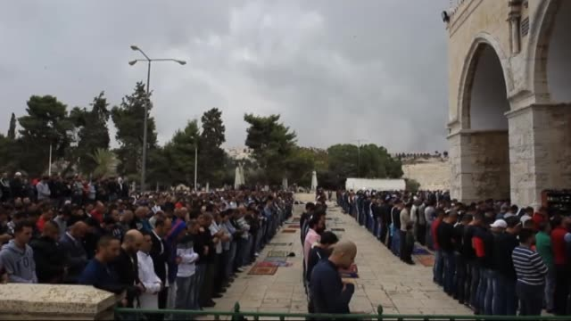 muslim worshippers perform friday prayer at the alaqsa mosque compound after israeli authorities remove the restriction on entering the mosque... - al aqsa mosque stock videos and b-roll footage