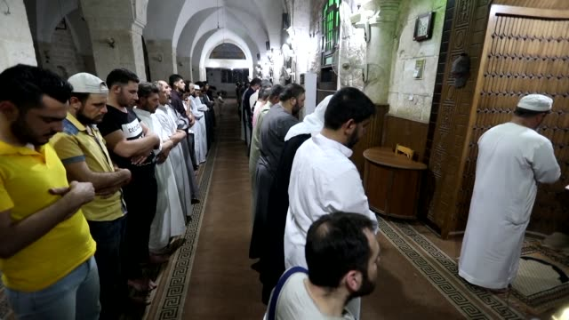 muslim worshippers pray at a mosque in maaret alnoman in syria's northwestern idlib province on the occasion of lailat alqadr which marks the night... - worshipper stock videos and b-roll footage