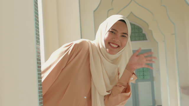 muslim young woman greeting-stock video - harmony stock videos & royalty-free footage